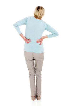 view woman: back view of senior woman having backache isolated on white background