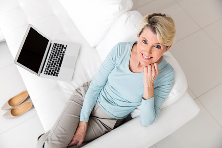 middle adult: top view of middle aged woman with laptop computer at home Stock Photo