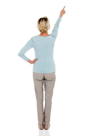 rear view of senior woman pointing empty copy space isolated on white