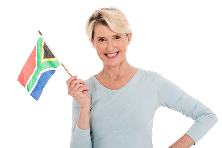 south african flag: happy senior woman holding south african flag