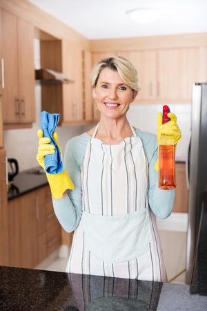 spotless: portrait of beautiful senior woman doing housework