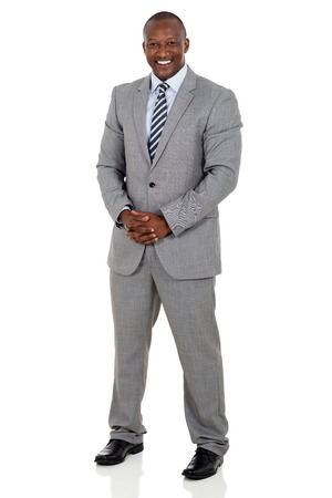 men standing: full length portrait of black business man isolated on white