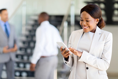 african american woman: beautiful young african american career woman using cell phone Stock Photo