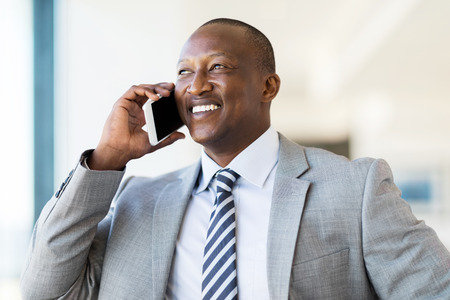african business: handsome african businessman talking on cell phone Stock Photo