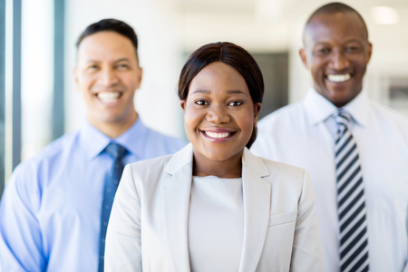 african business: beautiful young african businesswoman with business team Stock Photo