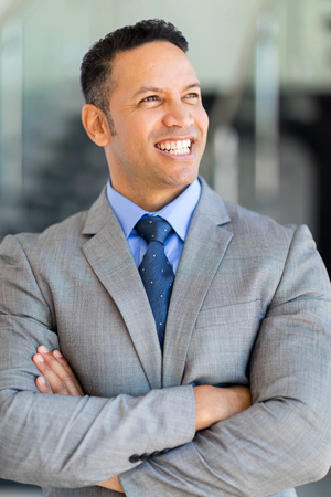one mid adult man: portrait of good looking mature business executive