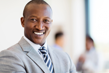 african business: close up portrait of happy african businessman