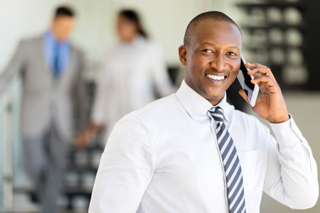 business man phone: professional african business executive talking on mobile phone