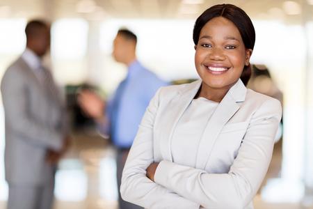 close up portrait of african america businesswoman at car dealership Foto de archivo