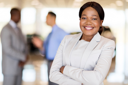 close up portrait of african america businesswoman at car dealership Stock Photo