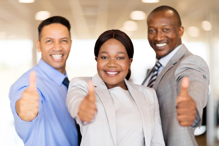 staff: portrait of beautiful car dealership staff giving thumbs up