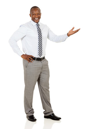 presenting: happy african businessman doing welcome gesture on white background Stock Photo