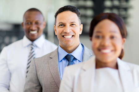african american woman business: group of happy business executives standing in a row