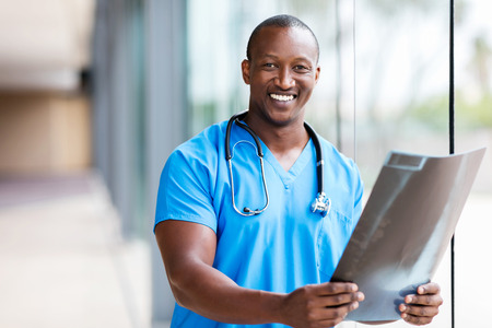 professional african medical doctor holding CT scan