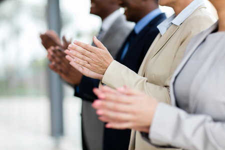 clapping hands: business group applauding during meeting presentation Stock Photo