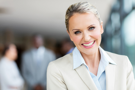 mid age: close up portrait of cheerful mid age businesswoman Stock Photo