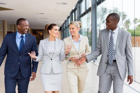 beautiful multiracial businesspeople walking together in office building Zdjęcie Seryjne - 55734612