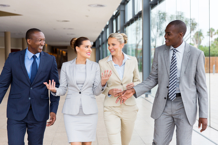 beautiful multiracial businesspeople walking together in office building
