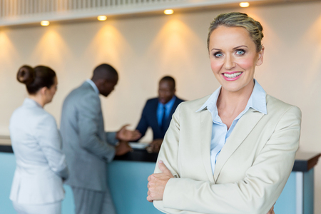 beautiful bank manager with customers on background Stockfoto