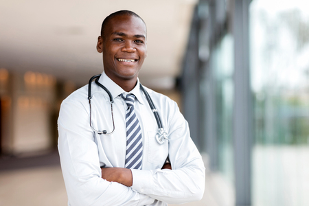 black nurse: good looking black medical doctor with arms crossed Stock Photo