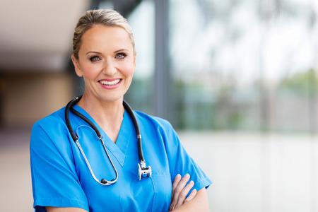 healthcare portrait: portrait of pretty female healthcare worker in office Stock Photo
