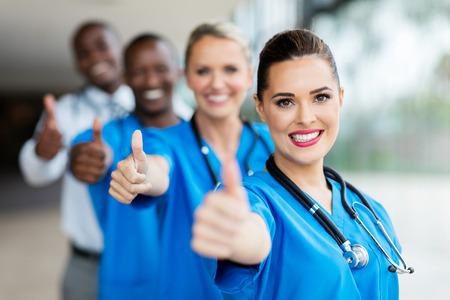 thumbsup: cheerful medical team giving thumbs up