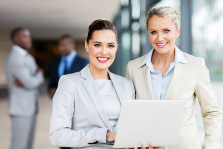 middle age: beautiful businesswomen using laptop in office