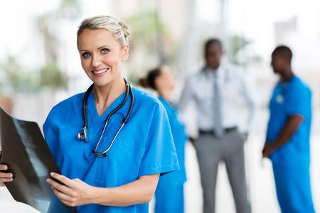 beautiful female doctor holding CT scan in office Standard-Bild