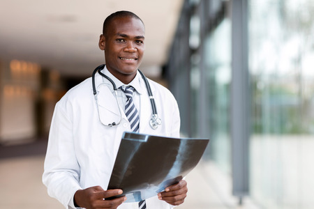 handsome african american male doctor holding x ray Standard-Bild
