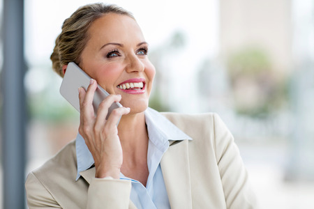 attractive mature business executive talking on mobile phone