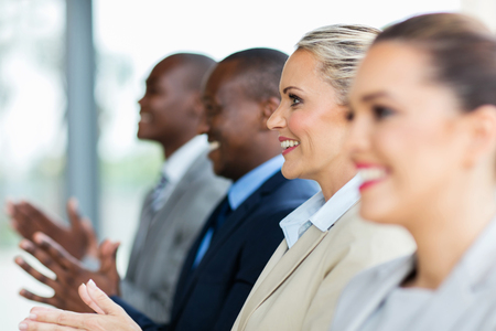 group of multicultural business people applauding