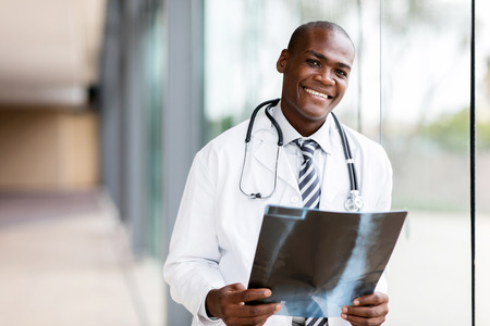 portrait young african medical doctor holding patient's x-ray Standard-Bild