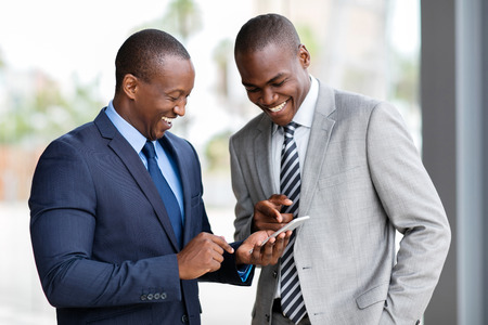 happy african: happy african businessmen using smart phone Stock Photo