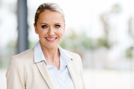 middle adult: beautiful middle aged businesswoman in modern office Stock Photo