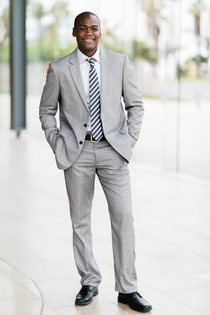 portrait young afro american businessman standing in office