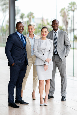 businessman in office: group of multiracial businesspeople standing together in office