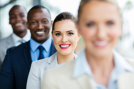 group of happy multiracial business people in a row