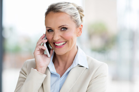 portrait of mid age businesswoman talking on cell phone