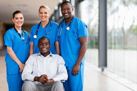 professional health workers and disabled patient Stockfoto