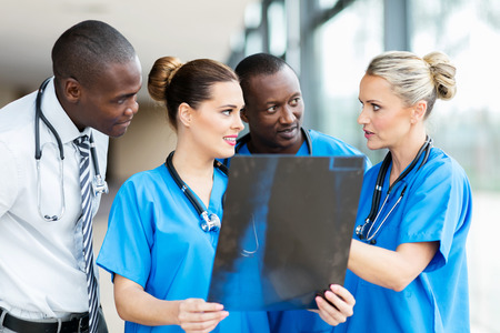 group of professional medical workers discussing patient's x-ray