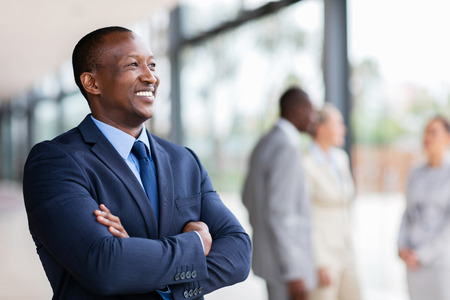 relaxed african american businessman looking away