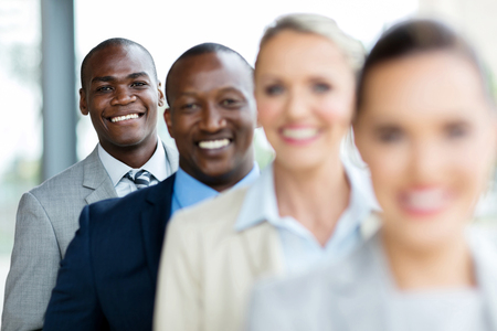 group of happy business executives standing in a row