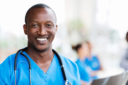 smiling african medical professional with stethoscope Stockfoto