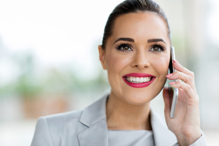 portrait of gorgeous young office worker making phone call Standard-Bild