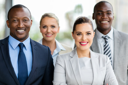 group of happy businesspeople in modern office