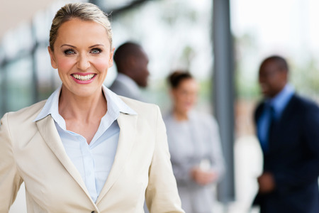 portrait of cheerful mid age business executive in office Stockfoto
