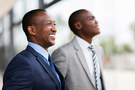 successful african businesspeople looking away