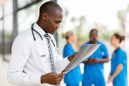professional african medical worker looking at patient's x-ray at hospital