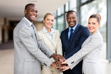 successful business team putting their hands together