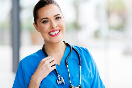 pretty female healthcare worker closeup portrait in office Stockfoto